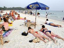 Регулярное пребывание на солнце спасет от рака груди
